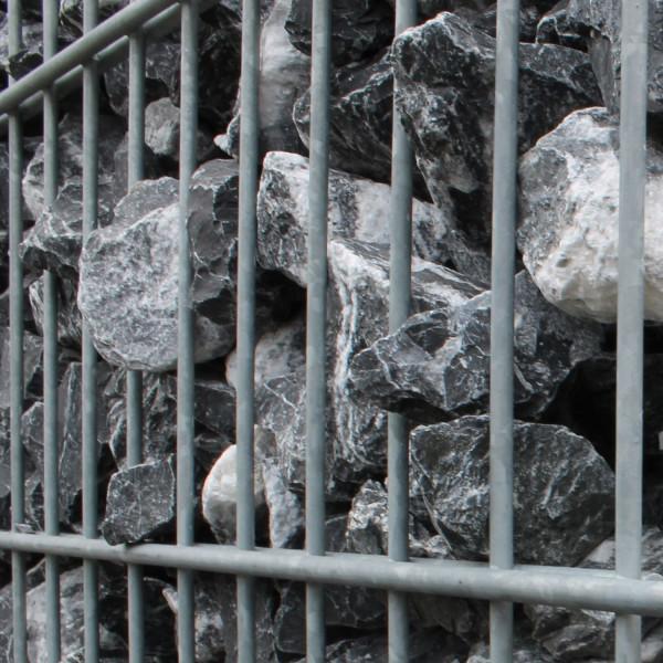 Steinzaun aus Steinkoerben als Sichtschutzwand